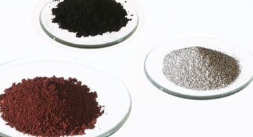 Photo of three types of test dust in round dishes